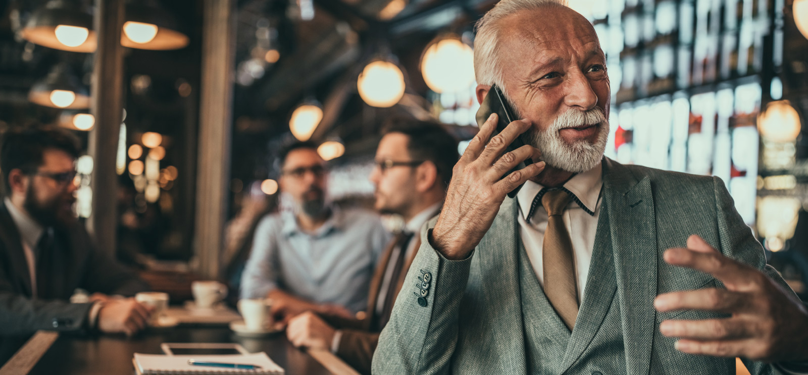 Business man taking phone call during meeting